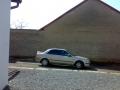Mazda 323 instalace protislunecni autofolie Llumar na autosklo AT15,70